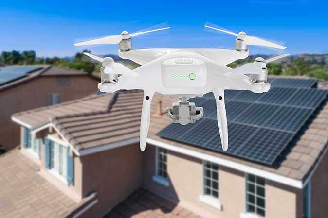 Aerial drone flying over a florida neighborhood during a home inspection