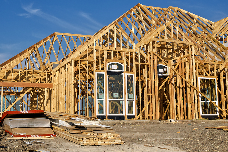 Wood beam framing of a new house being constructed before a home inspection is preformed