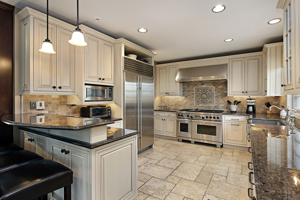 Upscale kitchen in a luxury house being inspected by one of our home inspectors
